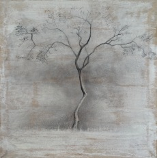 A black and white tree done in charcoal on prepared paper